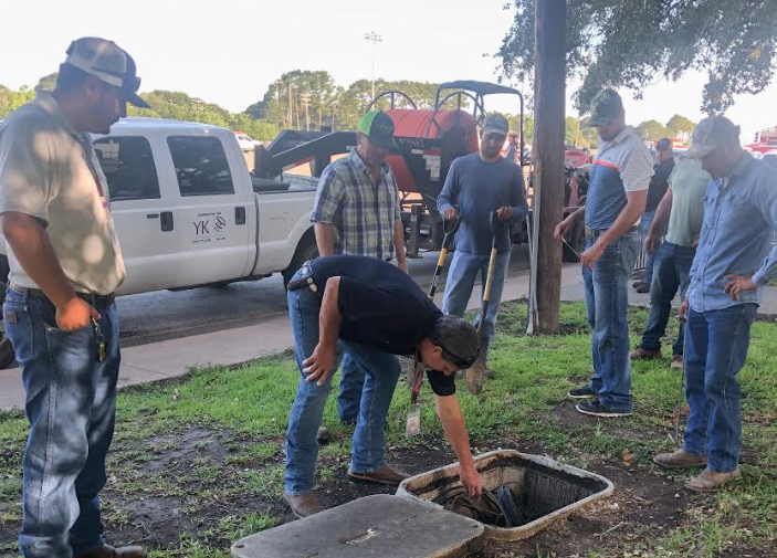 YK Communications technicians work to install a fiber optic network for ECISD.