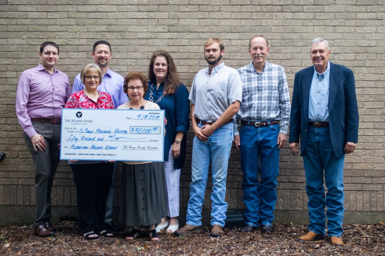 rural telecommunications provider presents check to local hospital